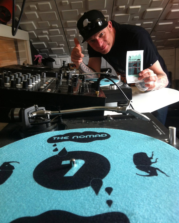 The Nomad (DJ & producer, New Zealand) with one of his custom slipmat designs